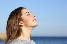 Woman portrait breathing deep fresh air on the beach.jpg