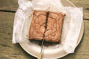 Knife cutting homemade brownie
