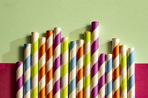 Colorful variegated drinking straws.