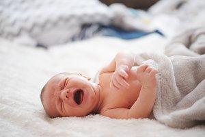 cute newborn baby at home