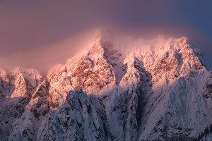 Sunrise in the mountains covered wit