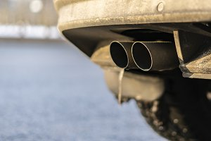 close up exaust pipe of a car releas