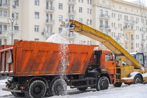 snow plow removing snow from the roa