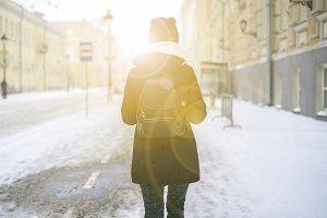pretty woman walk in city wear warm