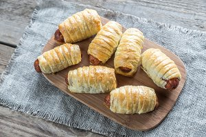 Sausage rolls on the board