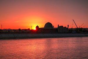 Sunset over Muhammad Imam Iyshan mes