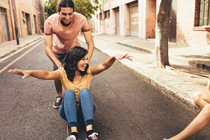 Couple having fun with skateboard