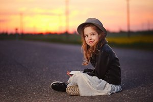 little funny girl with smartphone