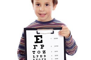 Child with a vision exam chart