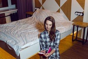 young girl in plaid shirtsitting on