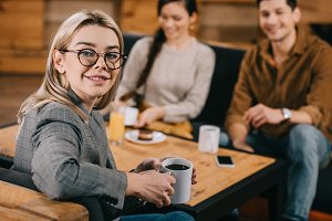 selective focus of woman in glasses