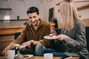 happy man and woman sitting in cafe