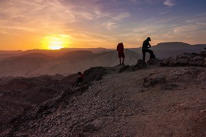 Hikers watching the sunset