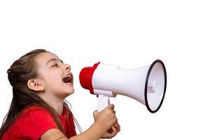 Little girl screaming on a megaphone