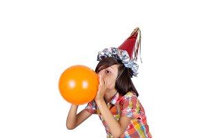Little boy inflating a balloon.