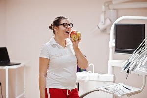 Portrait of female dentist woman sta