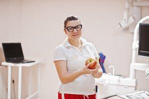 Portrait of female dentist woman at