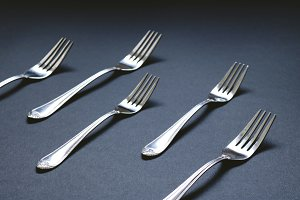 lot of forks laid on table