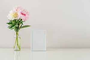 White frame and flowers