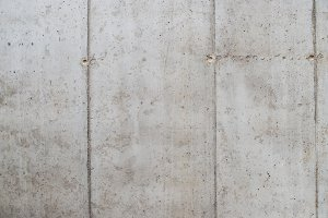 A concrete wall background. A copy
