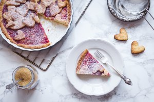 Raspberries jam pie with heart shape