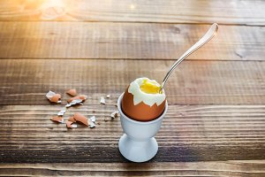 Boiled eggs on wooden table ready to