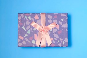 Purple gift box with pink knot
