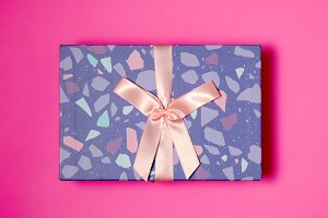 Purple gift box with pink knot decor
