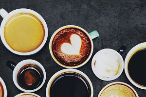 Assorted coffee cups on a background