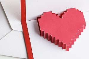 Pixelated heart in an envelope