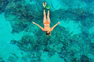 Young woman snorkeling in sea
