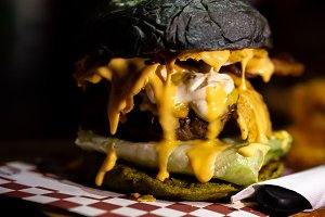 Juicy and greasy rustic cheese burge