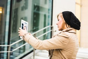 Blonde woman using a digital tablet