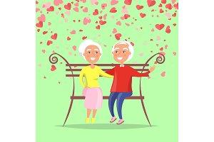 Elderly Man Hugging Woman Sitting on