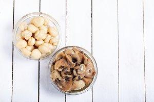 Fresh pickled mushrooms on a white w