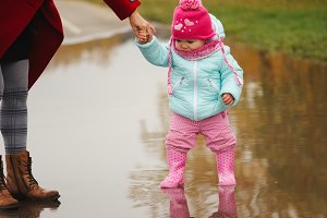 little girl with rubber boots in