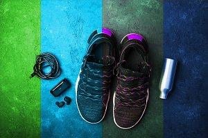 Sneakers, headphones, water bottle