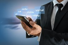BUSINESSMAN USING YOUR SMARTPHONE