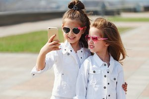 stylish funny little girls on the
