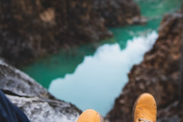 Feet of nature explorer sitting ove…