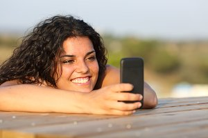 Funny girl watching media in smart phone.jpg