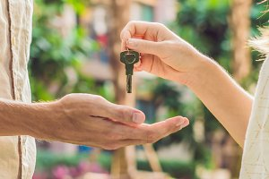 Real estate agent giving keys to