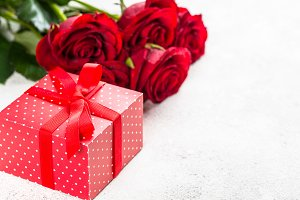 Red roses flower and present box on