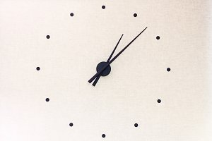black clock hands on the wall