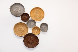 Wicker dishes on the light wall