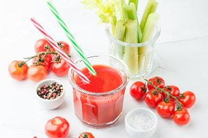 Glass of tomato juice and celery