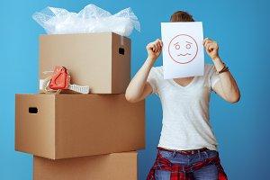 woman near cardboard box hiding behi