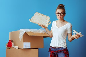 sad modern woman near cardboard box