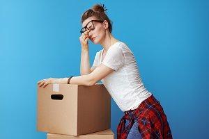 stressed modern woman near cardboard