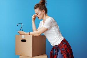 stressed young woman near cardboard